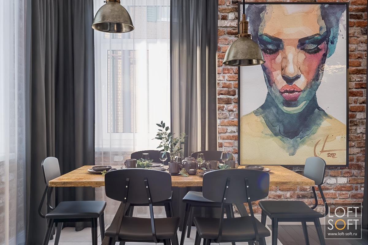 Дизайн интерьера. Черный текстиль икартины накирпичной стене.